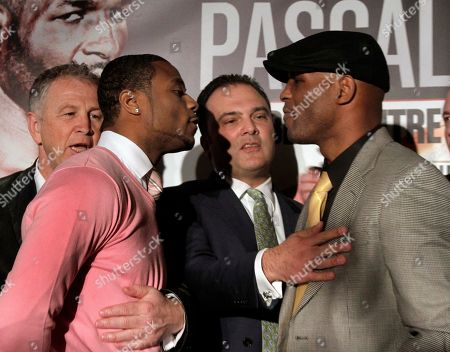 Bernard Hopkins, Jean Pascal, Yvon Michel, Richard Schaefer Yvon Michel, left, president of GroupYvonMichel, and Golden Boy Promotions CEO Richard Schaefer, third left, separate boxers Jean Pascal, second left, and Bernard Hopkins during a news conference at Planet Hollywood, in New York, . The boxers are scheduled to meet in Montreal on May 21 for Pascal's WBC-IBO light heavyweight title