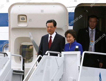 Hu Jintao, Liu Yongqing Chinese President Hu Jintao and wife Liu Yongqing arrive at Joint Base Pearl Harbor-Hickam for the APEC Summit, in Honolulu
