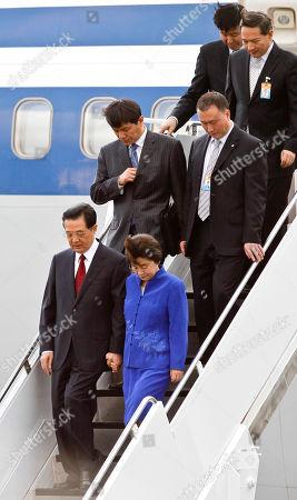 Hu Jintao Chinese President Hu Jintao and wife Liu Yongqing arrive at Joint Base Pearl Harbor-Hickam for the APEC Summit, in Honolulu
