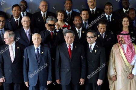 Representatives in front row from left, President of UN General Assembly Joseph Deiss, Egyptian Foreign Minister Nabil al-Arabi, Indonesian President Susilo Bambang Yudhoyono, Indonesian Foreign Minister Marty Natalegawa and Kuwait's Foreign Minister Mohammad Al-Sabah Al-Salem Al-Sabah prepare for a group photo at the 16th Ministerial Conference of the Non-Aligned Movement (NAM) in Nusa Dua, Bali, Indonesia
