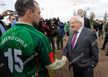 Michael Higgins Irish President Michael Higgins, right, shakes hands with Ian Johnson, left, a player on the Seattle Gaels Gaelic football team, during a visit to Skyline High School, in Sammamish, Wash. Higgins was at the school to speak to students and watch a game of Gaelic Football, which is taught in Skyline's physical education program. The visit was part of a four-day stop in the Seattle area