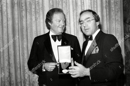 Arledge Butensky Roone Arledge, left, president of ABC News and Sports, receives the International Radio and Television Society Gold Medal Award from Avram Butensky, president of IRTS, in New York City