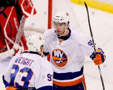 John Tavares, Doug Weight New York Islanders center Doug Weight (93) congratulates center John Tavares after Tavares scored a goal during the first period of an NHL hockey game against the Florida Panthers, in Sunrise, Fla