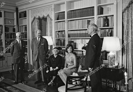 Mrs. Jacqueline Kennedy poses with officers of the American Institute of Interior Designers at the formal opening of the restored and refurnished White House ground floor library in Washington on . From left are: Stephen Jussel, New York; Milton Glaser, president of the A.I.D.; Mrs. Francis Henry Lenygon, New York; Mrs. Jacqueline Kennedy; Mrs. Ellen Lehman McCluskey, New York and J.H. Leroy Chambers, past president of the organization attended