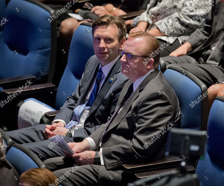 Stock Image of Josh Earnest, Joe Gibbs Current White House Press Secretary Josh Earnest, left, sits with former White House Press Secretary Robert Gibbs, right, at the Newseum in Washington, during a memorial service for James S. Brady, former White House press secretary to President Ronald Reagan. Brady was partially paralyzed as a result of the 1981 assassination attempt on President Reagan, and died Aug. 4, 2014 at the age of 73. A federal law requiring a background check on handgun buyers bears Brady's name, as does the White House press briefing room