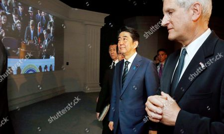 Shinzo Abe, Edwin Schlossberg Japanese Prime Minister Shinzo Abe, second from right, tours the John F. Kennedy Presidential Library in Boston, with Edwin Schlossberg, right