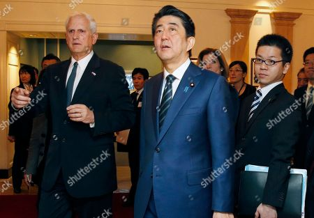 Shinzo Abe, Edwin Schlossbert Japanese Prime Minister Shinzo Abe, center, tours the John F. Kennedy Presidential Library in Boston, with Edwin Schlossberg, left