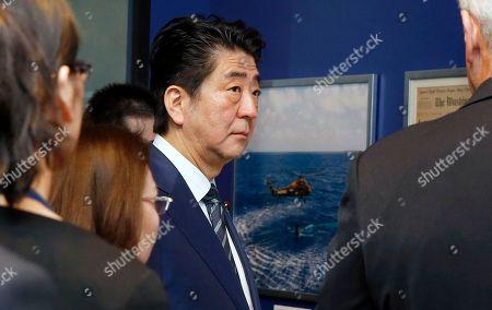 Shinzo Abe, Edwin Schlossberg Japanese Prime Minister Shinzo Abe, center, tours the John F. Kennedy Presidential Library in Boston, with Edwin Schlossberg, right