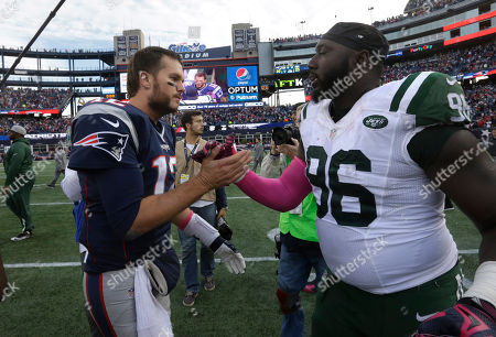 Stock Picture of Tom Brady, Muhammad Wilkerson New England Patriots quarterback Tom Brady (12), left, greets New York Jets defensive end Muhammad Wilkerson (96), right, following an NFL football game, in Foxborough, Mass