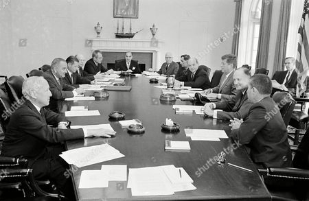 John F. Kennedy, J. Edward Day, Lyndon Johnson, Robert McNamara, Charles Murphy, W. Willard Wirtz, Anthony Celebrezze, Luther Hodges, John Douglas, Dean Rusk, Douglas Dillon, Stewart Udall President John F. Kennedy, recently returned from a 10-day European trip, meets with his cabinet at the White House in Washington, . Clockwise, from left: Postmaster General J. Edward Day; Vice President Lyndon B. Johnson; Secretary of Defense Robert McNamara; Undersecretary of Agriculture Charles Murphy; Secretary of Labor W. Willard Wirtz; Secretary of Welfare Anthony Celebrezze; Secretary of Commerce Luther Hodges; Department of Justice John Douglas; Secretary of State Dean Rusk; Kennedy; Secretary of Treasury Douglas Dillon, and Secretary of the Interior Stewart Udall