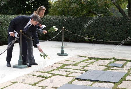 Victoria Lawford, William Kennedy Smith William Kennedy Smith and Victoria Lawford place white roses at the President John F. Kennedy grave site at Arlington National Cemetery, in Arlington, Va., before a U.S. Army Special Forces Command (Airborne) commemorative President John F. Kennedy Wreath Laying Ceremony