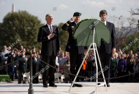 William Kennedy Smith, Darsie D. Rogers, John McHugh From left, U.S. Army Secretary John McHugh, Brig. Gen. Darsie D. Rogers, and William Kennedy Smith stand before a wreath in the shape of a Green Beret at Arlington National Cemetery, in Arlington, Va., during a U.S. Army Special Forces Command (Airborne) commemorative President John F. Kennedy Wreath Laying Ceremony at the JFK grave site