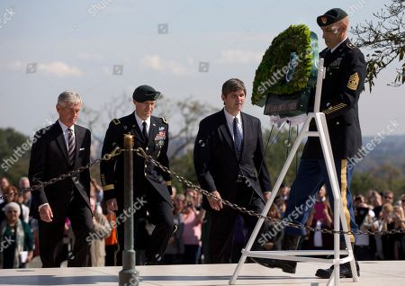 William Kennedy Smith, Darsie D. Rogers, John McHugh, Dwight Utley From left, Army Secretary John McHugh, Brig. Gen. Darsie D. Rogers, and William Kennedy Smith walk to lay a wreath in the shape of a Green Beret at Arlington National Cemetery, in Arlington, Va., during a U.S. Army Special Forces Command (Airborne) commemorative President John F. Kennedy Wreath Laying Ceremony at the JFK grave site. Sgt. Major Dwight Utley assists at right