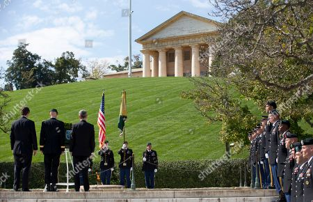 William Kennedy Smith, Darsie D. Rogers, John McHugh From left, William Kennedy Smith, Brig. Gen. Darsie D. Rogers, and Army Secretary John McHugh, stand before a wreath in the shape of a Green Beret at Arlington National Cemetery in Arlington, Va., during a U.S. Army Special Forces Command (Airborne) commemorative President John F. Kennedy Wreath Laying Ceremony at the JFK grave site. Arlington House, The Robert E. Lee Memorial sits atop the hill