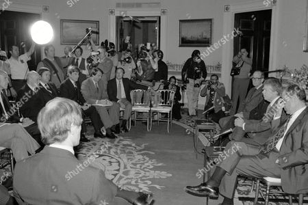 Stock Image of President Jimmy Carter and other administration officials meet with some of the new members of Senate and others at the White House in Washington, . From left those identifiable are: Sen. Alan Cranston (D-Calif.), Sen. David Boren (D-Okla.), Sen. John Warner (R-Va.), Frank Moore, Carter's congressional liaison; unidentified man; unidentified man; Carter; and Defense Secretary Harold Brown