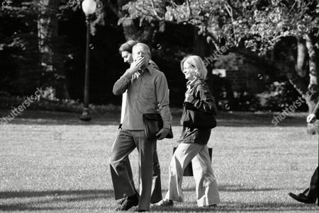 President Jimmy Carter throws a kiss and waves to the press as he leaves the White House for Camp David, Md., . Carter, originally scheduled to go to the presidential retreat Saturday, delayed his departure until after the Senate acted on his pending energy program. With Carter are his congressional liaison Frank Moore and personal secretary Susan Clough
