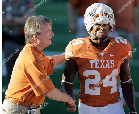 Bill Powers, Joe Bergeron Texas' Joe Bergeron (24) is congratulated by university president Bill Powers, left, during the second half of an NCAA college football game, in Austin, Texas. Texas won 35-13