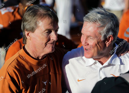 Bill Powers, Mack Brown Texas coach Mack Brown, right, walks off the field with university president Bill Powers, left, after Texas' 35-13 win over Kansas in an NCAA college football game, in Austin, Texas
