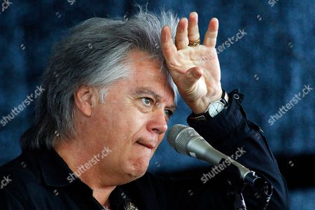 Marty Stuart Country music star Marty Stuart wipes his forehead during a mike check prior to his band's performance at a First Responders Remembrance salute, in Gulfport, Miss., in recognition of the 10th anniversary of Hurricane Katrina. Former President George W. Bush will join former Mississippi Gov. Haley Barbour, current Gov. Phil Bryant and other lawmakers in honoring the first responders with a concert and lunch
