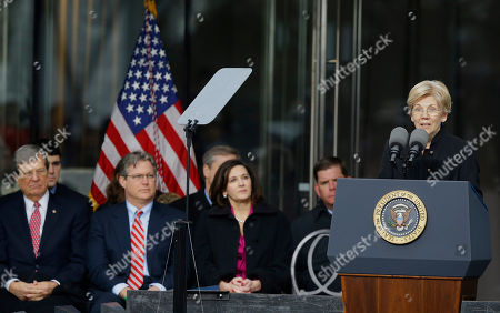 Sen. Elizabeth Warren, D-Mass., speaks during the dedication of the Edward M. Kennedy Institute for the United States Senate, in Boston. Former Sen. Trent Lott, R-Miss., left to right, Connecticut state Sen. Ted Kennedy, Jr., son of Edward M. Kennedy, left, and Victoria Reggie Kennedy, Kennedy's widow look on