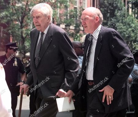 KENNEDY Economist John Kenneth Galbraith, left, and former Sen. Alan Simpson, of Wyoming, walk up Madison Avenue near the Church of St. Thomas More in New York where a quiet Mass was celebrated to honor the lives of John Kennedy Jr. and Carolyn Bessette Kennedy