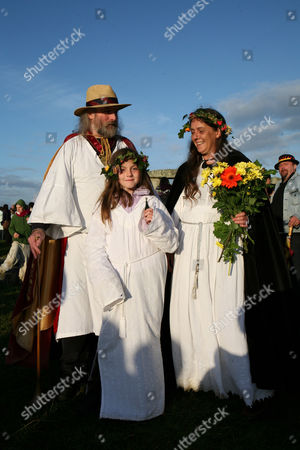 Stock Image of Archdruid of Stonehenge and Britain, Rollo Maughfling with his family after a ceremony at the stones. Summer solstice at Stonehenge. For the seventh year English Heritage's 'managed open access' of the Stonehenge stones for the summer solstice attracted thousands of folk to watch the sun rise at 4.58am, but they were disappointed when cloud crept across the horizon just a few moments before.