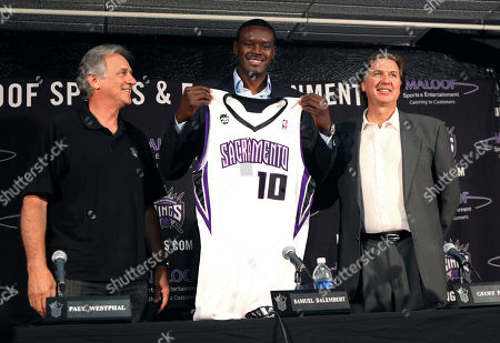 Stock Image of Paul Westphal, Samuel Dalembert, Geoff Petrie Sacramento Kings center Samuel Dalembert, center, holds up a Kings jersey while posing with Kings coach Paul Westphal, left, and president of basketball operations Geoff Petrie during a news conference in Sacramento, Calif., . Dalembert was acquired in a trade with the Philadelphia 76ers for Kings center Spencer Hawes and forward Andres Nocioni