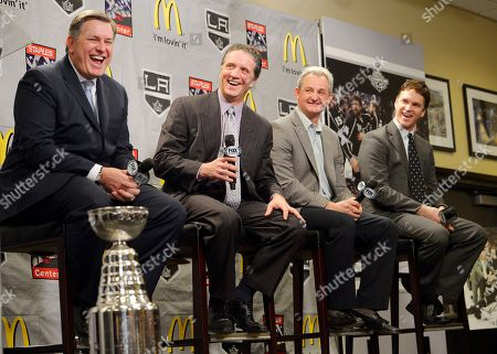 Tim Leiweke, Dean Lombardi, Luc Robitaille, Darryl Sutter From left, Tim Leiweke, president and CEO of Anschutz Entertainment Group, which owns the Los Angeles Kings, President and general manager Dean Lombardi, head coach Darryl Sutter and president of business operations Luc Robitaille laugh during a news conference to help kick off the NHL hockey team's upcoming season, in Los Angeles