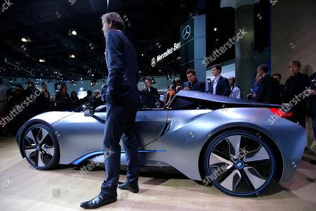 Adrian van Hooydonk Adrian van Hooydonk, senior vice president BMW group design, poses with the BMW i8 Concept at the LA Auto Show in Los Angeles