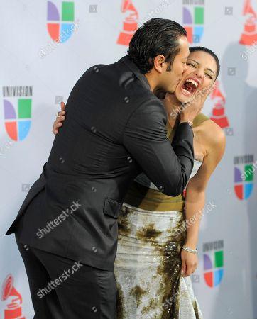 Carlos Anaya, Karen Hoyos Carlos Anaya kisses Karen Hoyos as they arrive at the 11th Annual Latin Grammy Awards, in Las Vegas