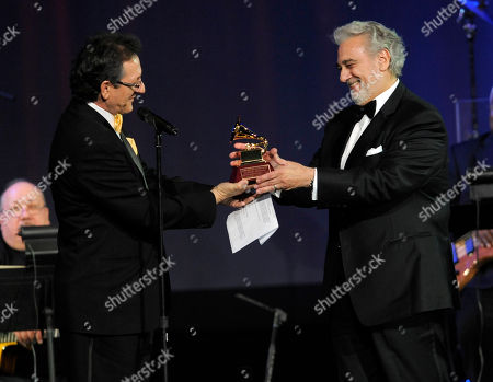 Gabriel Abaroa, Placido Domingo Latin Recording Academy President Gabriel Abaroa Jr., left, presents the award for best classic album to Placido Domingo at the Latin Recording Academy Person of the Year event honoring Placido Domingo, in Las Vegas
