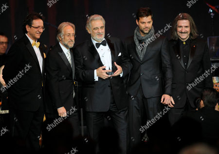 Gabriel Abaroa, Neil Portnow, Placido Domingo, Ricky Martin, Luis Cobos From left, Latin Recording Academy President Gabriel Abaroa Jr., President of the National Academy of Recording Arts and Sciences Neil Portnow, Placido Domingo with the Person of the Year award, Ricky Martin, and Luis Cobos are seen onstage at the Latin Recording Academy Person of the Year event honoring Placido Domingo, in Las Vegas