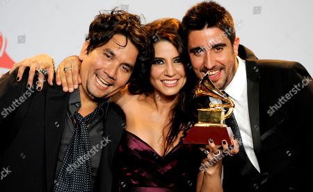 Jorge Villamizar, Lena Burke, Alex Ubago Jorge Villamizar, left, Lena Burke, center, and Alex Ubago pose with the award for best pop album by a duo or group backstage at the 12th Annual Latin Grammy Awards on in Las Vegas