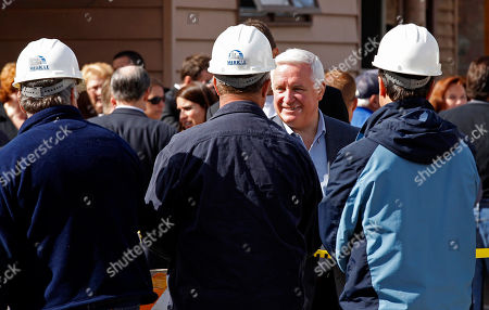 Tom Corbett Pennsylvania Gov. Tom Corbett. second from right, shakes hands with Mericle workers after a walk through a heavily damaged neighborhood in Duryea, Pa., . The homes were damaged by flood waters from the Lackawanna River swollen after the remnants of Tropical Storm Lee came through