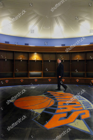 """Hank Ratner, president and CEO of The Madison Square Garden Company, shows off the new New York Knicks' locker room during a tour of completed areas of the arena currently under restoration on in New York. Ratner lead a tour of the Garden's ongoing """"comprehensive top to bottom transformation,"""" unveiling the first stage in the arena's $850 million restoration"""