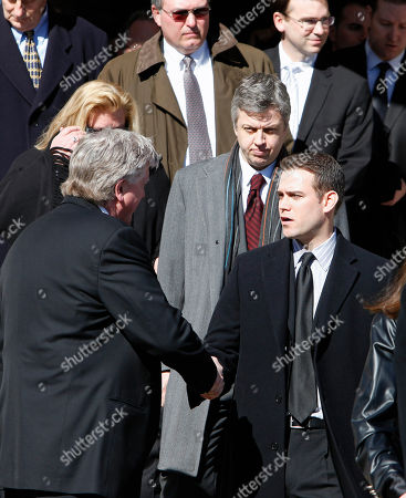 Stock Photo of Brian Burke, Theo Epstein Boston Red Sox general manager Theo Epstein, right, shakes hands with Brian Burk, president and general manager of the Toronto Maple Leafs, following a memorial service for Burke's son Brendan, in Canton, Mass