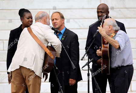 """Tracy Martin, Sybrina Fulton, Peter Yarrow, Paul Stookey, Mark Barden From left, Trayvon Martin's mother Sybrina Fulton, Peter Yarrow, Mark Barden, father of Daniel Barden who was killed in the Sandy Hook Elementary School shooting, Trayvon Martin's father Tracy Martin and Paul Stookey, perform at the Let Freedom Ring ceremony at the Lincoln Memorial in Washington, to commemorate the 50th anniversary of the 1963 March on Washington for Jobs and Freedom. It was 50 years ago today when Martin Luther King Jr. delivered his """"I Have a Dream"""" speech from the steps of the memorial"""