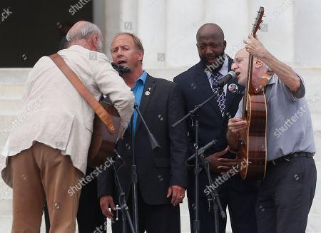 Sybrina Fulton, Tracy Martin, Mark Barden, Peter Yarrow, Paul Stookey With Trayvon Martin parents, Sybrina Fulton, obscured, and Tracy Martin, and Mark Barden, father of Sandy Hook Elementary School shooting victim Daniel Barden, Peter Yarrow, left, and Paul Stookey, right, of the folk trio Peter, Paul and Mary, perform at the 50th Anniversary of the March on Washington where Martin Luther King Jr., spoke, in front of the Lincoln Memorial in Washington