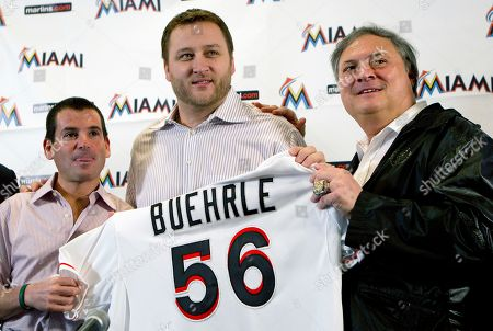 Mark Buehrle, David Sampson, Jeffrey Loria Miami Marlins president David Samson, left, pitcher Mark Buehrle, and owner Jeffrey Loria pose for photos after the team introduced Buehrle during a baseball news conference in Miami. In a span of five days, Loria signed All-Stars Jose Reyes, Mark Buehrle and Heath Bell to contracts worth a combined $191 million. All three deals are backloaded, with a steep escalation in the salaries over time. Even the signing bonuses for Buehrle and Bell are deferred until the end of the contracts