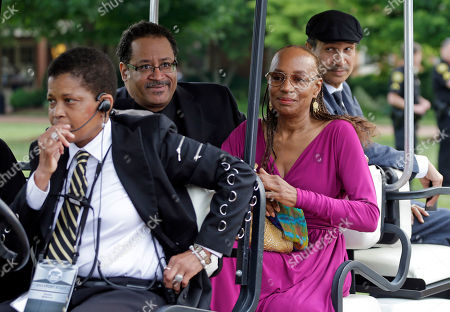 Micahel Eric Dyson, Susan L Taylor Michael Eric Dyson, second from left, and Susan L. Taylor, second from right, arrive outside Wait Chapel before a memorial service for poet and author Maya Angelou at Wait Chapel. at Wake Forest University in Winston-Salem, N.C., . Former President Bill Clinton and Oprah Winfrey are joining First Lady Michelle Obama at the service