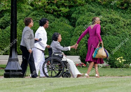 Susan L Taylor Susan L. Taylor, right, assists friends outside Wait Chapel before a memorial service for poet and author Maya Angelou at Wait Chapel. at Wake Forest University in Winston-Salem, N.C., . Former President Bill Clinton and Oprah Winfrey are joining First Lady Michelle Obama at the service