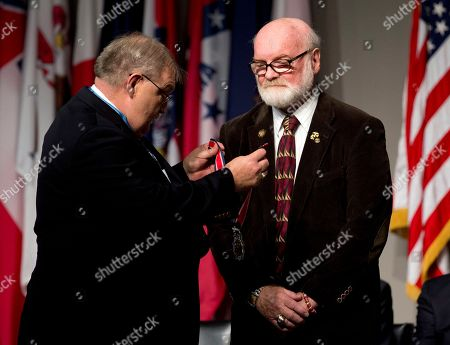 Stock Image of Michael Reagan, Michael Fitzmaurice Michael G. Reagan a Vietnam veteran from Edmonds Wa., is presented by Medal of Honor recipient Michael Fitzmaurice, left, with a Citizen Service Before Self Honors during a ceremony at Arlington National Cemetery, in Arlington, Va., in commemoration of the National Medal of Honor Day 2015. Reagan was selected for his service in founding the non-profit Fallen Heroes Project, which provides hand-drawn portraits to families of al servicemen and women who have been killed in Iraq and Afghanistan