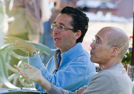 Stock Photo of Rob Wiesenthal, Jeffrey Katzengerg Rob Wiesenthal, executive vice president and CFO of Sony Corp, rear, and Jeffrey Katzenberg, CEO of DreamWorks Animation, hold discussions during lunch at the annual Allen & Co.'s media summit in Sun Valley, Idaho