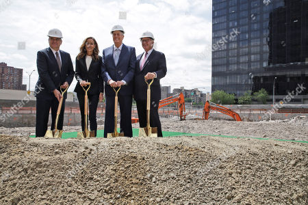 "David H. Koch, Julia Koch, Craig Thompson, Douglas 'Sandy' Warner Memorial Sloan Kettering Cancer Center President Craig Thompson, left, Julia Koch, second from left, David H. Koch, second from right, and Douglas ""Sandy' Warner, chairman of the board MSK, pose for photographers during a ""turning of the soil"" ceremony on the future site of The David H. Koch Center for Cancer Care, in New York. Koch has given $150 million to Memorial Sloan Kettering Cancer Center. His donation will help build a $1.3 billion, 23-story outpatient cancer center in Manhattan. It's expected to serve about 1,300 patients daily"