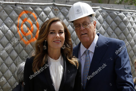 "David H. Koch, Julia Koch David H. Koch, right, and his wife Julia Koch are photographed during a ""turning of the soil"" ceremony on the future site of The David H. Koch Center for Cancer Care, in New York. Koch has given $150 million to Memorial Sloan Kettering Cancer Center. His donation will help build a $1.3 billion, 23-story outpatient cancer center in Manhattan. It's expected to serve about 1,300 patients daily"