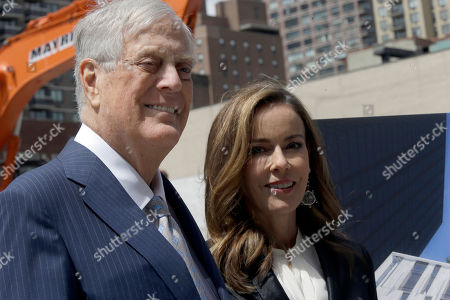 "David H. Koch, Julia Koch David H. Koch, left, and his wife Julia Koch are photographed during a ""turning of the soil"" ceremony on the future site of The David H. Koch Center for Cancer Care, in New York. Koch has given $150 million to Memorial Sloan Kettering Cancer Center. His donation will help build a $1.3 billion, 23-story outpatient cancer center in Manhattan. It's expected to serve about 1,300 patients daily"