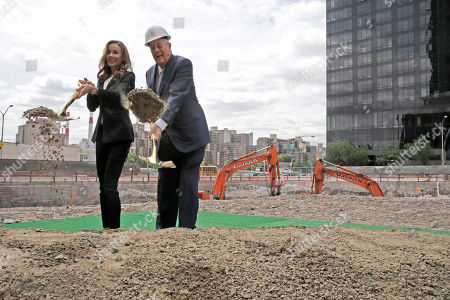 "David H. Koch, Julia Koch Julia Koch, left, and her husband David H. Koch pose for photographers during a ""turning of the soil"" ceremony on the future site of The David H. Koch Center for Cancer Care, in New York. Koch has given $150 million to Memorial Sloan Kettering Cancer Center. His donation will help build a $1.3 billion, 23-story outpatient cancer center in Manhattan. It's expected to serve about 1,300 patients daily"