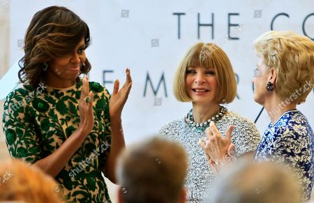 Michelle Obama Met Museum First lady Michelle Obama, left, and Metropolitan Museum of Art president Emily Rafferty, right, applaud Vogue editor Anna Wintour at a dedication ceremony for the Anna Wintour Costume Center, at the Metropolitan Museum of Art in New York