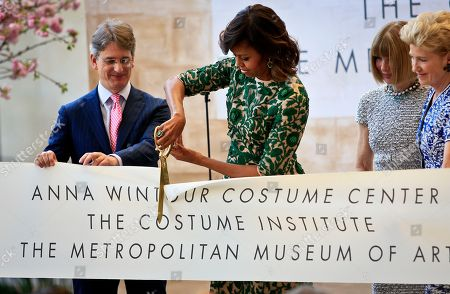 Stock Picture of Michelle Obama Met Museum Vogue editor Anna Wintour, second from right, Metropolitan Museum director Thomas Campbell, left, and museum president Emily Rafferty, right, looks on as first lady Michelle Obama cuts the ribbon at a dedication ceremony for the Anna Wintour Costume Center, at the Metropolitan Museum of Art in New York
