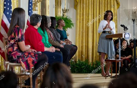 "Michelle Obama, Sherrilyn Ifill, Janaye Ingram, Chanelle Hardy, Vanessa DeLuca, Charlayne Hunter-Gault, Carlotta Walls First lady Michelle Obama, right, speaks in the East Room of the White House in Washington, during the ""Celebrating Women of the Movement,"" event honoring Black History Month. On stage with the first lady from left are, Janaye Ingram, National Executive Director of the National Action Network, Carlotta Walls, member of the Little Rock Nine, Sherrilyn Ifill, President and Director-Counsel of the NAACP Legal Defense and Educational Fund, Charlayne Hunter-Gault, activist and journalist, Chanelle Hardy, National Urban League Senior Vice President, and Vanessa DeLuca, Editor-in-chief of Essence Magazine"